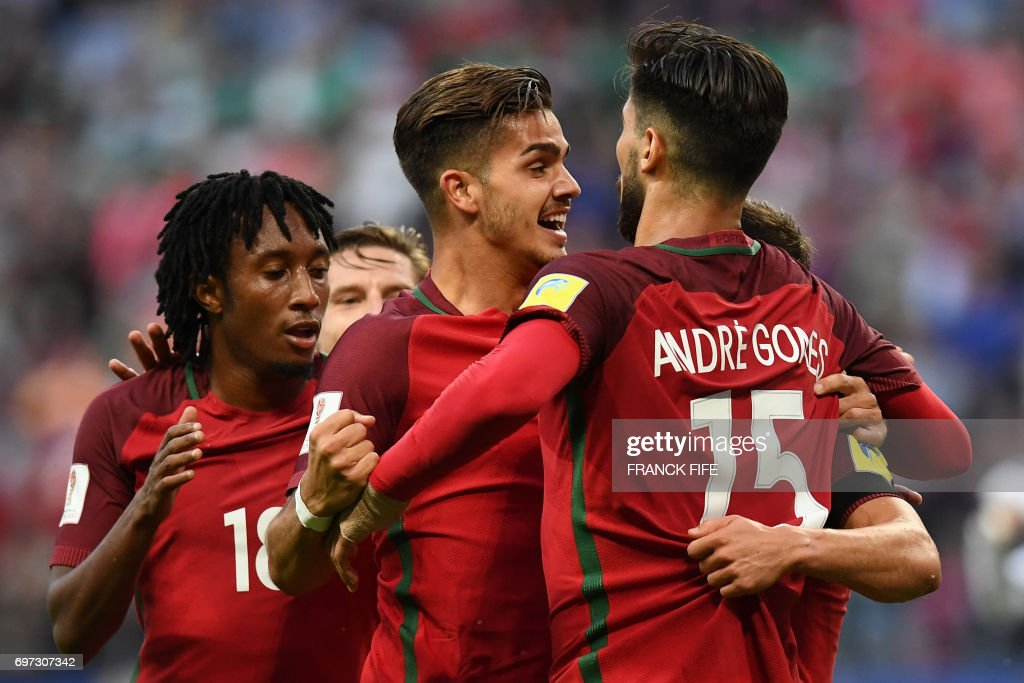 TOPSHOT - Portugal#s players celebrate after Portugal's defender Cedric scored during the 2017 Confederations Cup group A football match between Portugal and Mexico at the Kazan Arena in Kazan on June 18, 2017. /