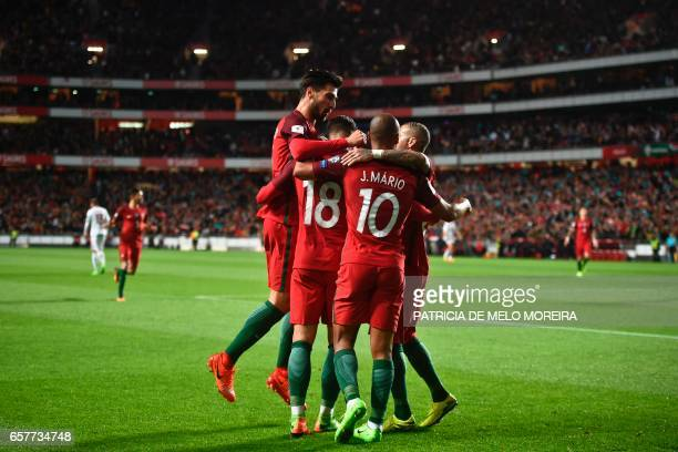 Portugal's players celebrate after Portugal's forward Andre Silva scored during the WC 2018 group B football qualifing match Portugal vs Hungary at...