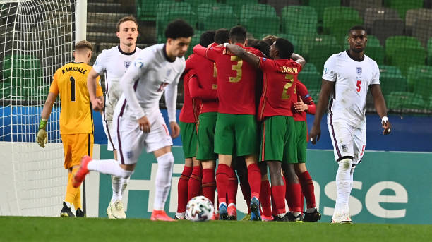Portugal's players celebrate after scoring a penalty during the 2021 UEFA European Under-21 Championship Group D football match between Portugal and...