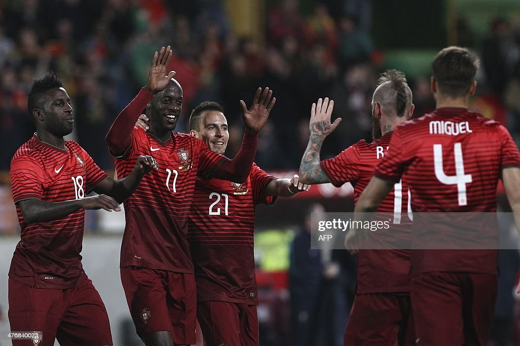Portugal's players celebrate after scoring during the FIFA 2014 World Cup friendly football match Portugal vs Cameroon at Magalhaes Pessoa stadium in Leiria on March 5, 2014.