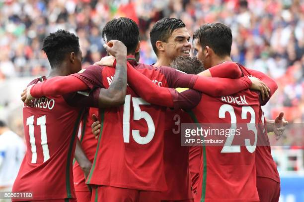 TOPSHOT Portugal's players celebrate after winning the 2017 FIFA Confederations Cup third place football match between Portugal and Mexico at the...