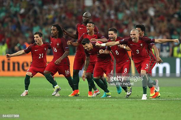 TOPSHOT Portugal's players celebrate after winning the Euro 2016 quarterfinal football match between Poland and Portugal at the Stade Velodrome in...