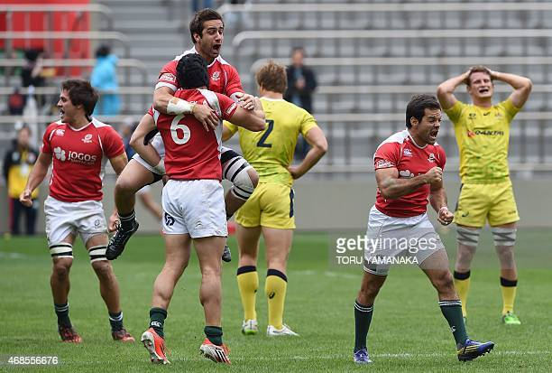 Portugal's players celebrate during their match against Australia at the Tokyo Rugby Sevens in Tokyo on April 4, 2015. Portugal defeated Australia...