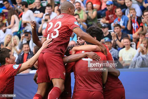 Portugal's players celebrate their second goal during the UEFA Under 21 European Championship 2015 semi final football match between Portugal and...