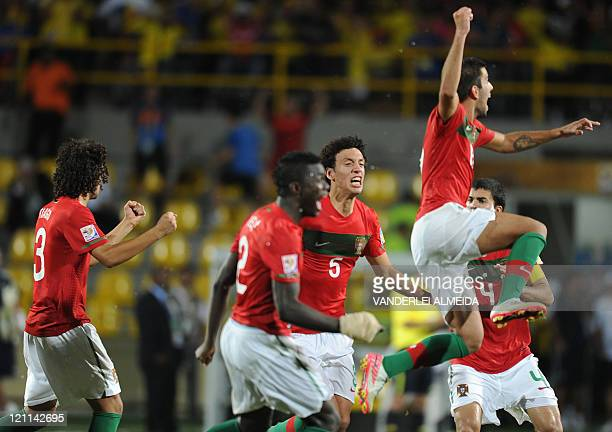 Portugal's players celebrate their victory over Argentina during their FIFA World Cup U20 football match at Jaime Moron Olimpic stadium in Cartagena...