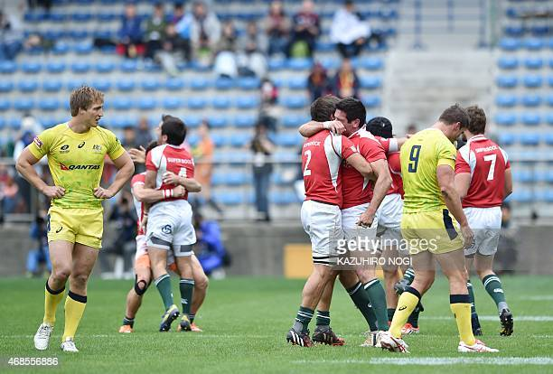 Portugal's players celebrate their win over Australia after their match at the Tokyo Rugby Sevens in Tokyo on April 4, 2015. Portugal won the match...