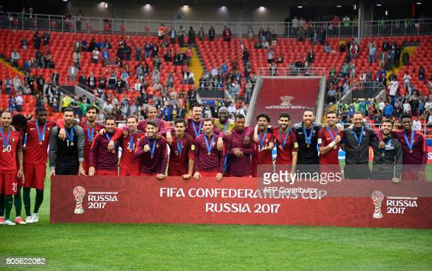 TOPSHOT Portugal's players celebrate with their bronze medals at the end of the 2017 FIFA Confederations Cup third place football match between...