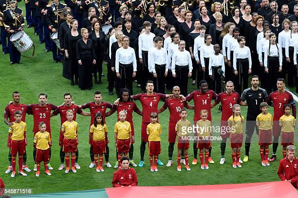 Portugal's players sing the national anthem during the closing ceremony ahead the Euro 2016 final football match between Portugal and France at the...