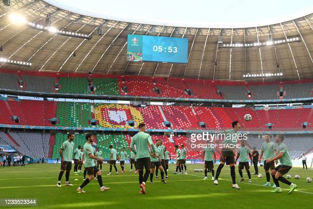 Portugal's players take part in the MD-1 training session at the Allianz Arena in Munich on June 18 on the eve of their UEFA EURO 2020 Group F...