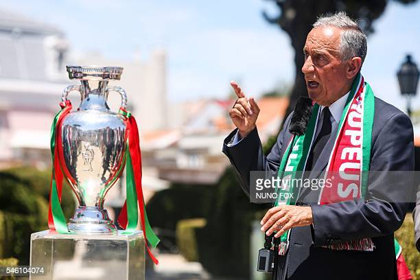 Portugal's President Marcelo Rebelo de Sousa addresses Portugal's football team as they celebrate their victory at Belem Palace on July 11 2016 after...