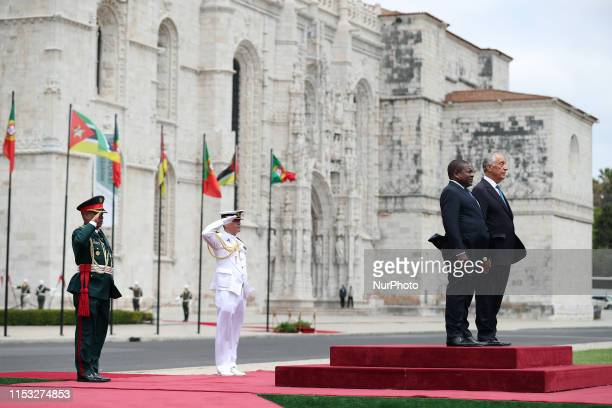 Portugal's President Marcelo Rebelo de Sousa and Mozambique's president Filipe Nyusi listens to the national anthems during a welcome ceremony at the...