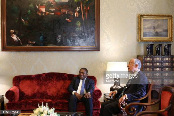 Portugal's President Marcelo Rebelo de Sousa chats with Mozambique's president Filipe Nyusi during their meeting at the Belem Palace in Lisbon,...