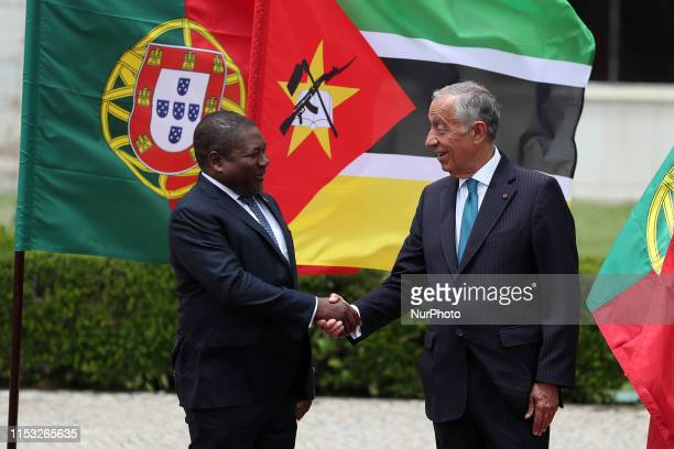 Portugal's President Marcelo Rebelo de Sousa shake hands with Mozambique's president Filipe Nyusi during a welcome ceremony at the Jeronimos...