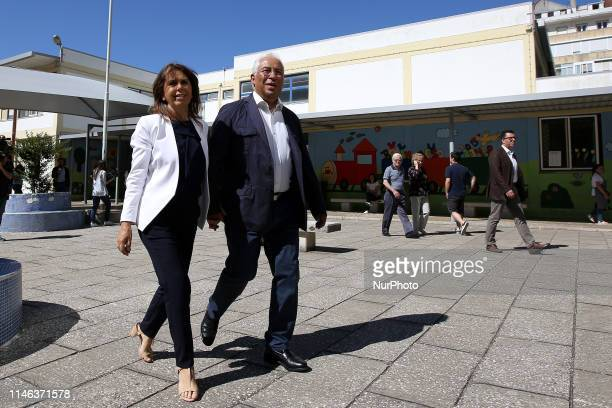 Portugal's Prime Minister and leader of the Socialist Party Antonio Costa leaves with his wife Fernanda Tadeu after casted his ballot at a polling...