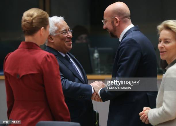 Portugal's Prime Minister Antonio Costa and President of the European Council Charles Michel shake hands during a special European Council summit in...