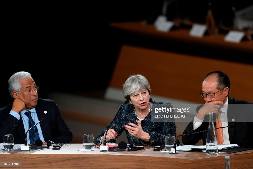 Portugal's Prime minister Antonio Costa, Britain's Prime minister Theresa May and World Bank President Jim Yong Kim take part in a session of the One Planet Summit on December 12, 2017, at La Seine Musicale venue on l'ile Seguin in Boulogne-Billancourt, southwest of Paris. The French President hosts 50 world leaders for the 'One Planet Summit', hoping to jump-start the transition to a greener economy two years after the historic Paris agreement to limit climate change. / AFP PHOTO / Eric FEFERBERG