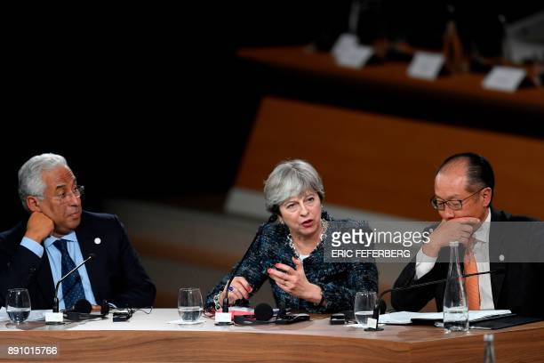Portugal's Prime minister Antonio Costa Britain's Prime minister Theresa May and World Bank President Jim Yong Kim take part in a session of the One...