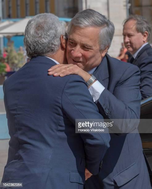 Portugal's Prime Minister Antonio Costa greets EU Parliament President Antonio Tajani outside the PM office in Praca do Comercio on September 28,...