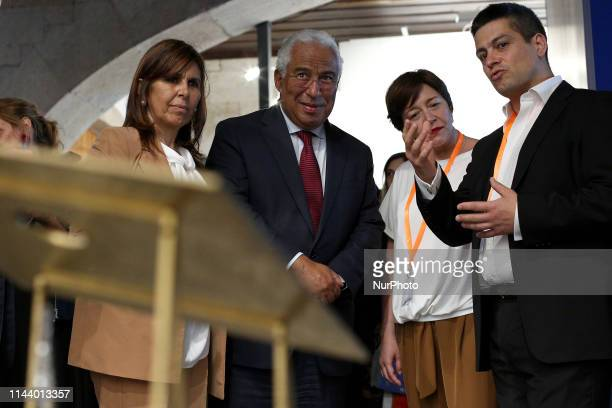 Portugal's Prime Minister Antonio Costa looks on an art piece with his wife Fernanda Tadeu during the official inauguration of the International...