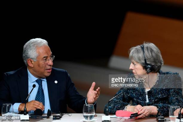 Portugal's Prime minister Antonio Costa speaks to Britain's Prime minister Theresa May during a session of the One Planet Summit on December 12 at La...