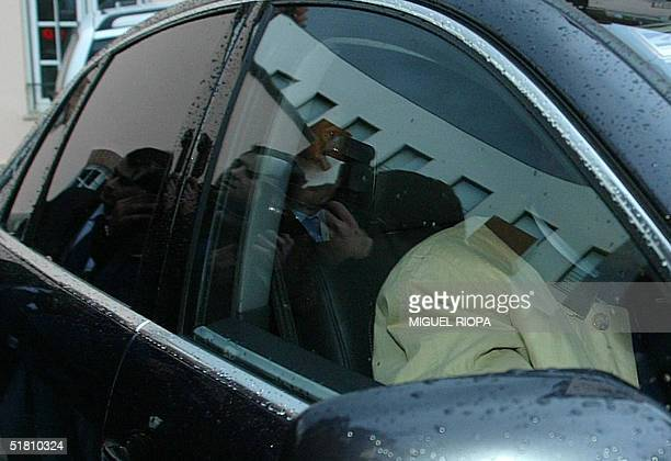 Portugal's Prime Minister Pedro Santana Lopes arrives into his official car at the PSD's headquarters in Lisbon 1 December 2004 to take part in a...