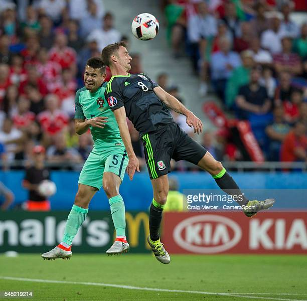 Portugal's Raphael Guerreiro vies for possession with Wales's Andy King during the UEFA Euro 2016 Semifinal match between Portugal and Wales at Stade...