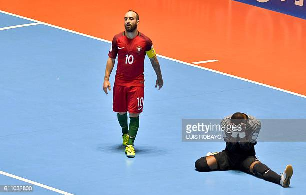 Portugal's Ricardinho and Bebe react after getting scored by Argentina during their Colombia 2016 FIFA Futsal World Cup match at the Coliseo El...