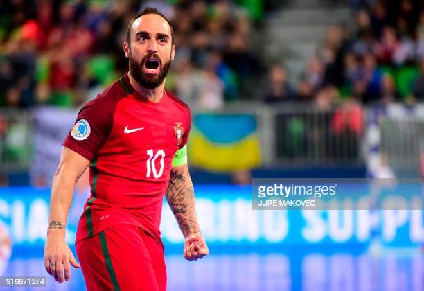 Portugals Ricardinho celebrates after scoring a goal during the European Futsal Championship final football match between Portugal and Spain at Arena...