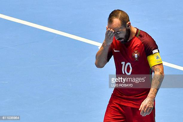 Portugal's Ricardinho reacts after being defeated by Argentina during their Colombia 2016 FIFA Futsal World Cup match at the Coliseo El Pueblo...