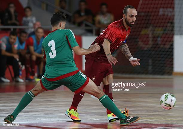 Portugal's Ricardinho with Morocco's Mohamed Jouad in action during the Futsal International Friendly match between Portugal and Morocco at Pavilhao...