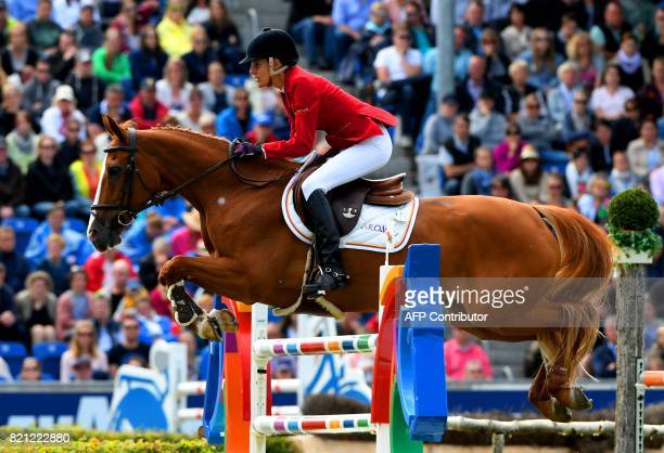 TOPSHOT Portugal's rider Luciana Diniz with her horse FitForFun 13 jumps over an obstacle during the Grand Prix of Aachen during the World Equestrian...
