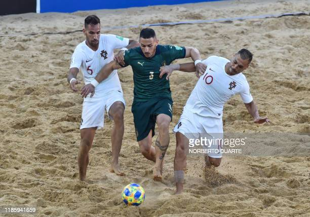 Portugal's Ruben Brilhante and Belchior vie for the ball with Italy's Marcello Percia during their final FIFA Beach Soccer World Cup Paraguay 2019...