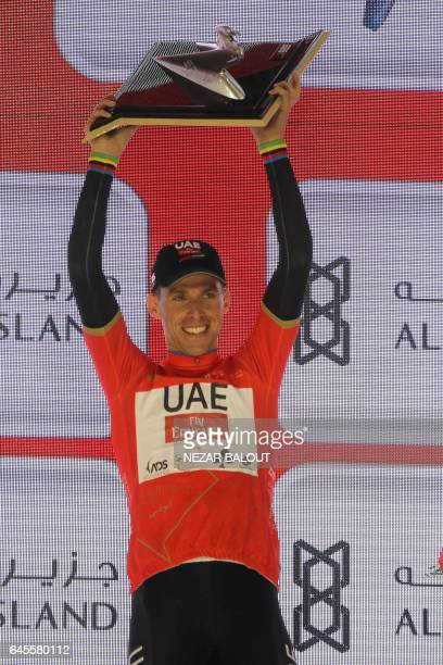 Portugal's Rui Costa, wearing the overall leader red jersey, celebrates on stage after winning the final Yas Island stage of the Tour of Abu Dhabi,...