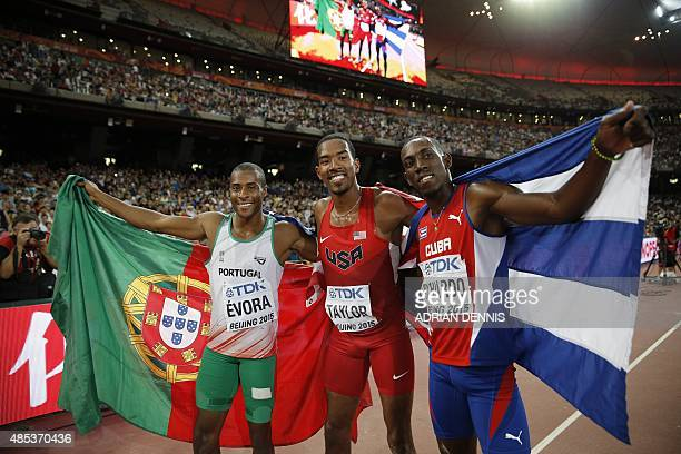 Portugal's silver medallist Nelson Evora USA's gold medallist Christian Taylor and Cuba's bronze medallist Pedro P Pichardo celebrate after the final...