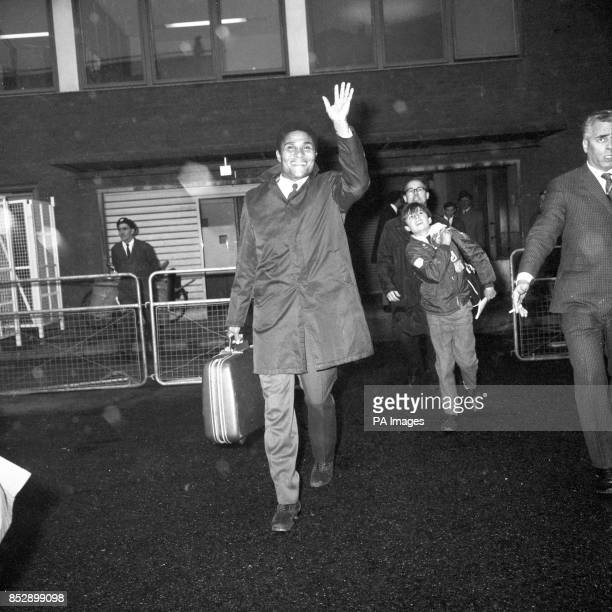 Portugal's soccer star Eusebio Silva Ferreira waves to children on a balcony on his arrival at Heathrow Airport The Benfica team are due to play...