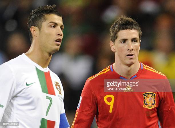 Portugal's striker Cristiano Ronaldo and Spain's striker Fernando Torres are pictured during the 2010 World Cup round of 16 match Spain versus...