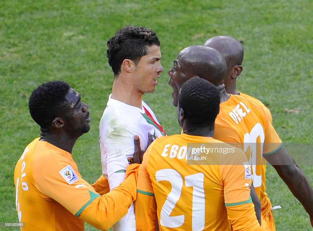 Portugal's striker Cristiano Ronaldo (back, L) argues with Ivory Coast's defender Guy Demel (2ndR) during the Group G first round 2010 World Cup football match Ivory Coast vs. Portugal on June 15, 2010 at Nelson Mandela Bay stadium in Port Elizabeth. NO