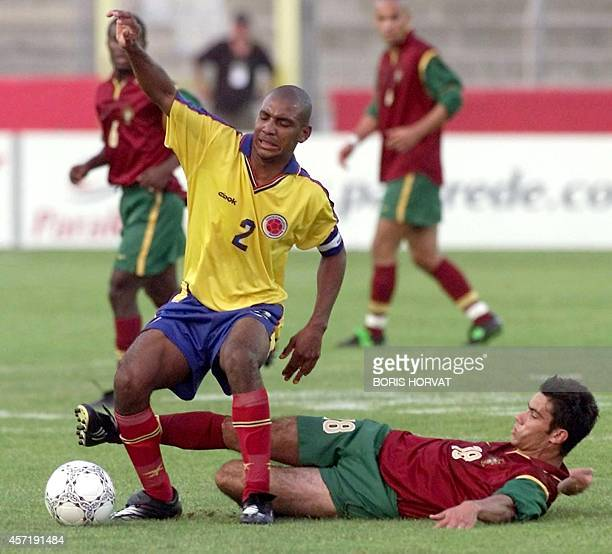 Portugal's striker Luis Felipe tackles Colombia's Jose Mera 03 June 2000 during their under 21's match at the 28th Under 21's Festival of Toulon.