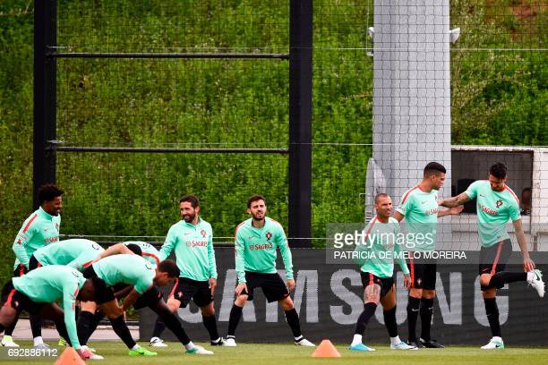 Portugal's team players warm up during a training session at 'Cidade do Futebol' training camp in Oeiras outskirts of Lisbon on June 6 2017 two days...