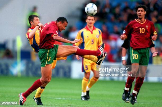 Portugal's Vidigal and Romania's Adrian Ilie battle for the ball
