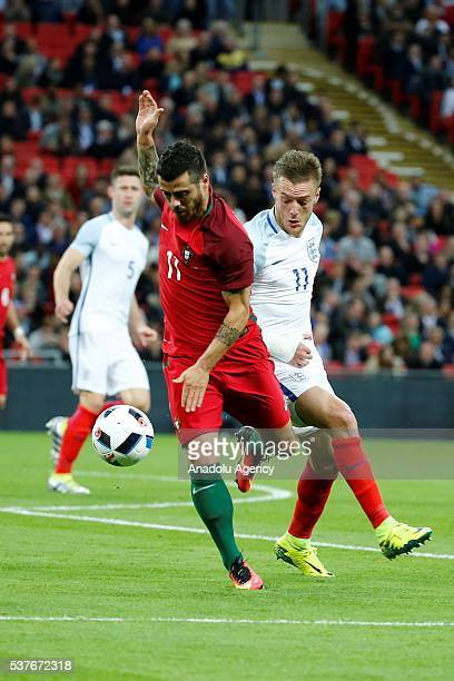 Portugal's Vieirinha vies with England's James Vardy during an international friendlies match between England and Portugal at Wembley Stadium on June...
