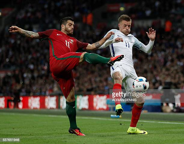 Portugal's Vieirinha vies with England's striker Jamie Vardy during the friendly football match between England and Portugal at Wembley stadium in...