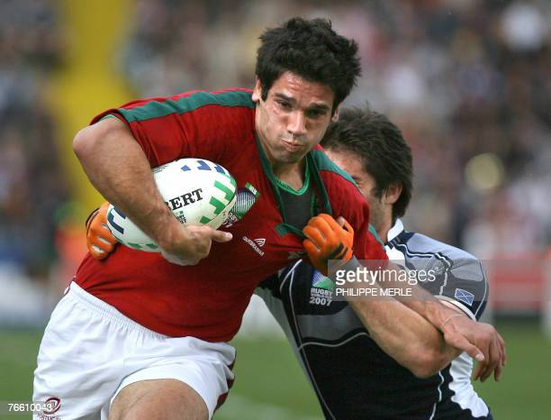 Portugal's winger David Mateus is tackled by Scotland's centre Marcus Di Rollo during the rugby union World Cup match Scotland vs. Portugal, 09...