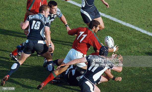 Portugal's winger Pedro Carvalho powers in to score a try despite Scotland's fly-half Dan Parks and winger Simon Webster during the rugby union World...