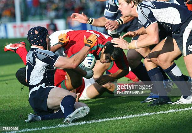 Portugal's winger Pedro Carvalho scores a try during the rugby union World Cup match Scotland vs. Portugal, 09 September 2007 at the Geoffroy...