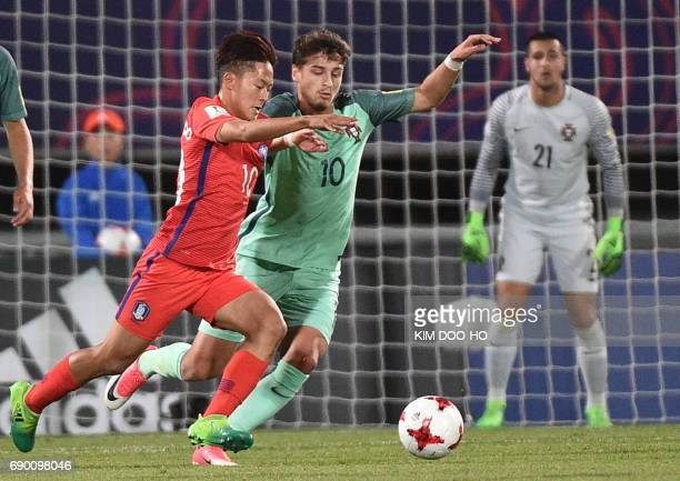 Portugal's Xadas fights for the ball with South Korea's Lee SeungWoo during the FIFA Under 20 World Cup round of 16 football match in Cheonan on May...