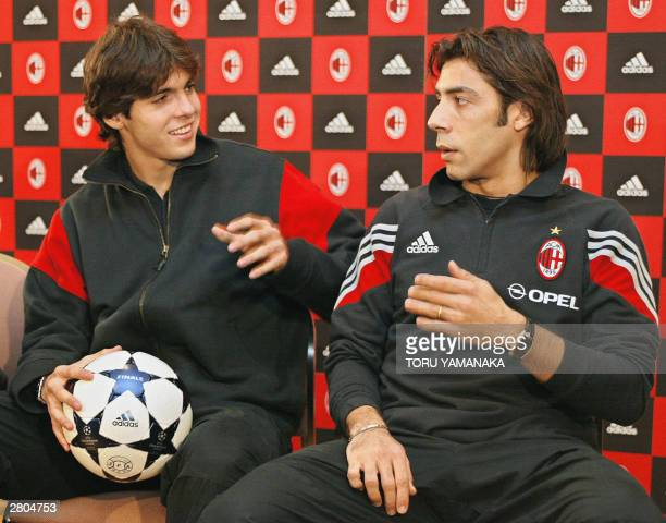 Portugeese midfielder Rui Manuel Cesar Costa of Italian football club AC Milan chats with his Brazilian teammate Kaka during a press conference in...