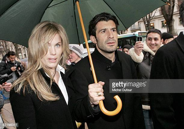 Portugese footballer Luis Figo and wife Helena leave their Paris hotel The Plaza to attend Real Madrid teammate Ronaldo's engagement party at...