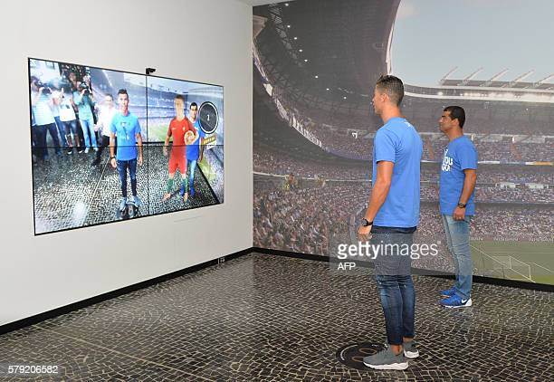 Portugese forward Cristiano Ronaldo and his brother Hugo Aveiro visit the new location of the CR7 museum dedicated Ronaldo's professional career at...
