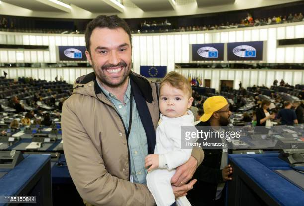 Portugese Member of the European Parliament Francisco Guerreiro with his daughter is talking with the British MEP Magid Magid attend a session of the...